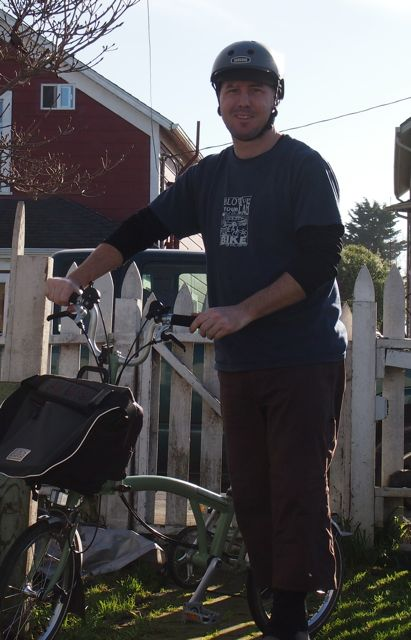 This is the author Chris standing with his brompton bicycle