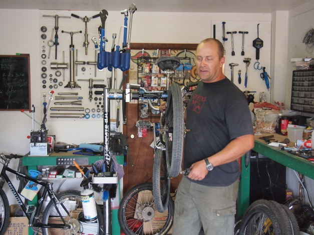 Jacob inside the shop, working on a customers bicycle !