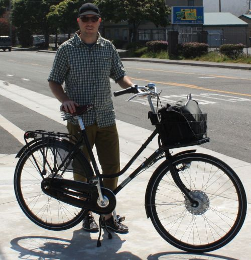 This is the author Chris standing with his workcycles secret service bicycle